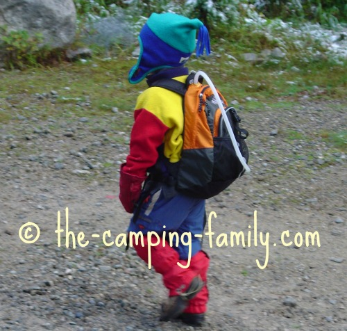 small boy with orange backpack