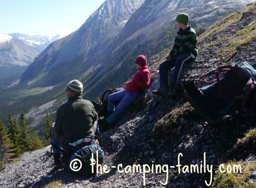 backpacking family resting in the mountains