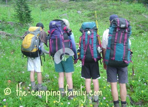 4 hikers wearing backpacks
