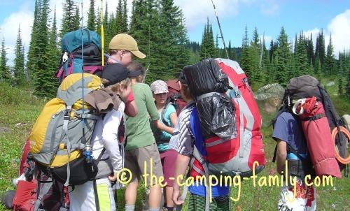 backpackers wearing loaded backpacks