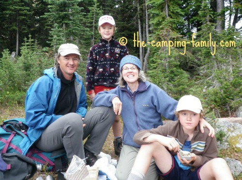 backpacking family stopped for lunch