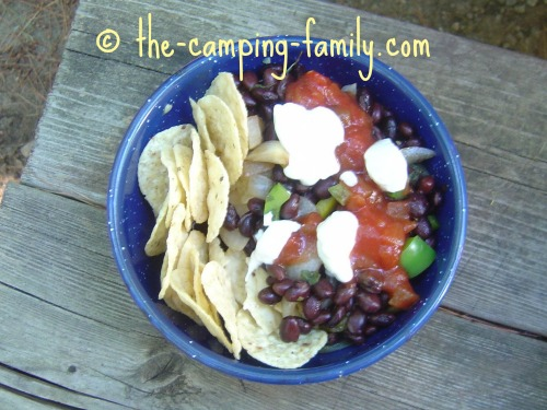 Balsamic Black Beans in a bowl with salsa and sour cream