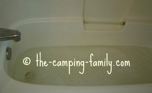 bathtub full of sudsy water
