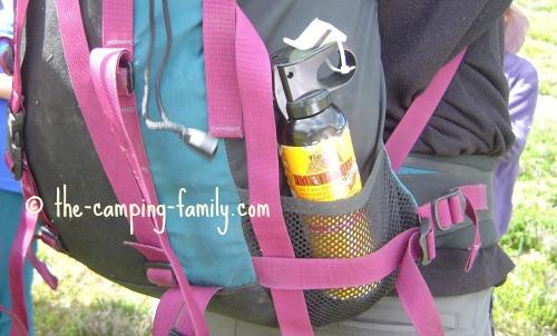 bear spray in outside pocket of backpack