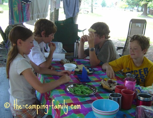 kids playing board games at the picnic table