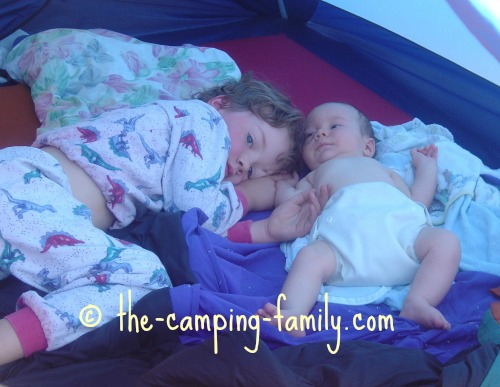 two small boys in a tent