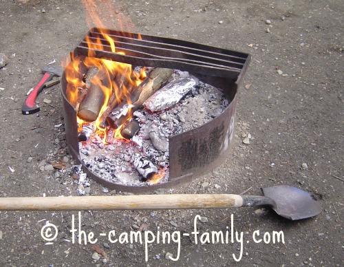 spade beside campfire