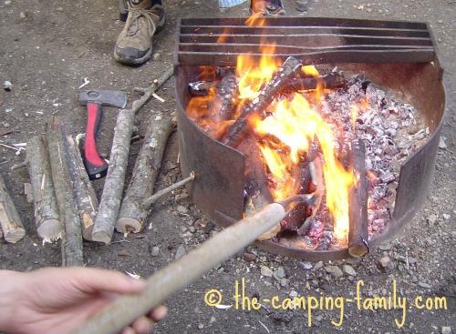 rearranging coals with spade
