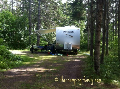 trailer in wooded campground