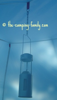 candle lantern hanging in a tent
