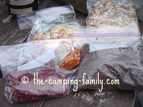 ziploc bags with chili ingredients at camp