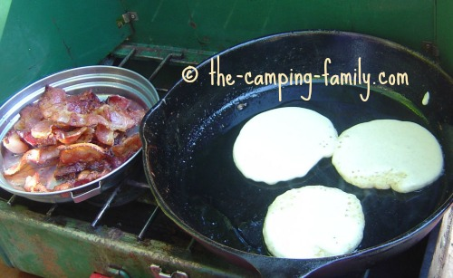 pancakes and bacon on camping stove