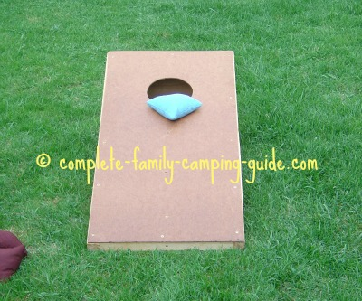 cornhole game with bag on board