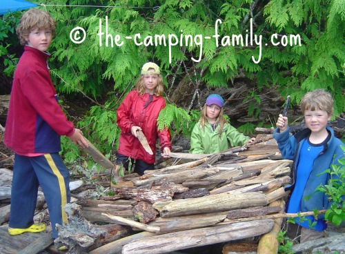 children making driftwood fort