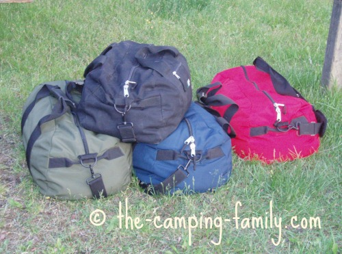 colored duffle bags on grass