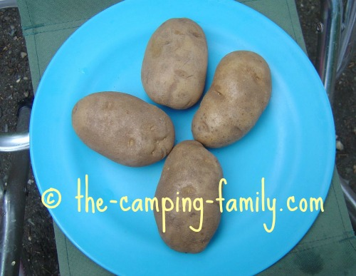 four potatoes on a plate