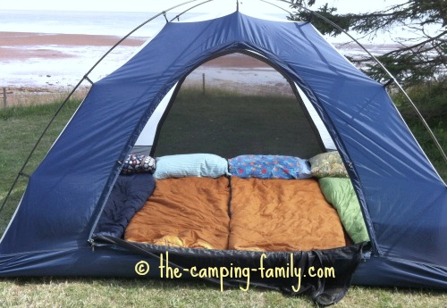 small tent with four sleeping bags on Thermarests