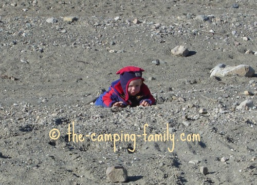toddler crawling in the dirt