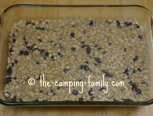 glass baking dish with granola bar mixture