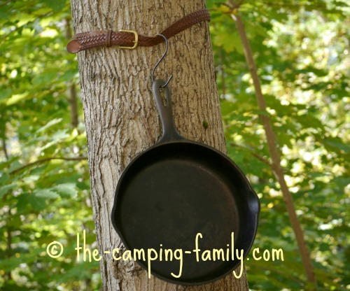 cast iron pan hung on tree