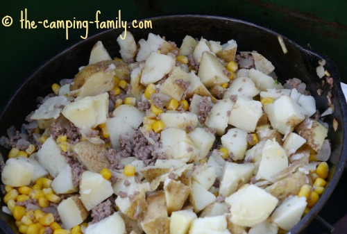 ground beef, potatoes and corn in skillet