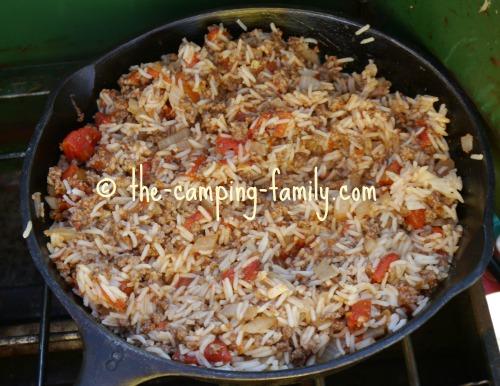 hamburger, rice, tomatoes and rice in skillet