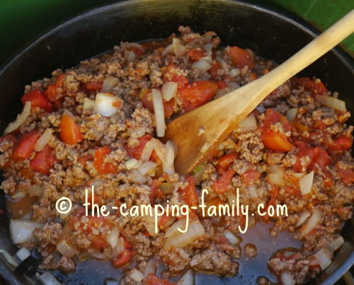 hamburger, rice and tomatoes in skillet