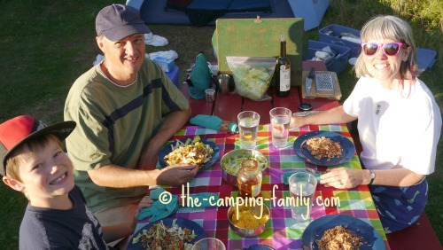 camping family at picnic table