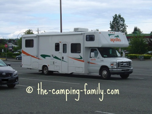 large motorhome in mall parking lot