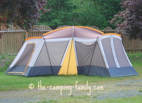 large tent with many poles in sleeves