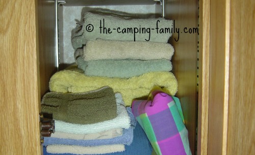 towels in RV cupboard