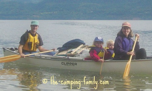 family in loaded canoe