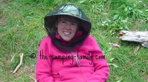 woman wearing bug head net