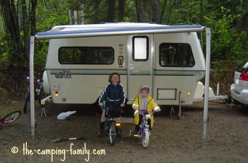two boys beside Bigfoot trailer