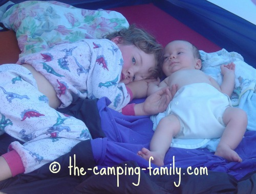 little boy and baby in tent
