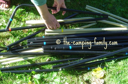 pile of color coded tent poles