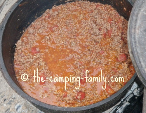 ground beef and tomato sauce in Dutch oven