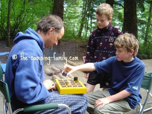 father and sons playing the Gobblet game