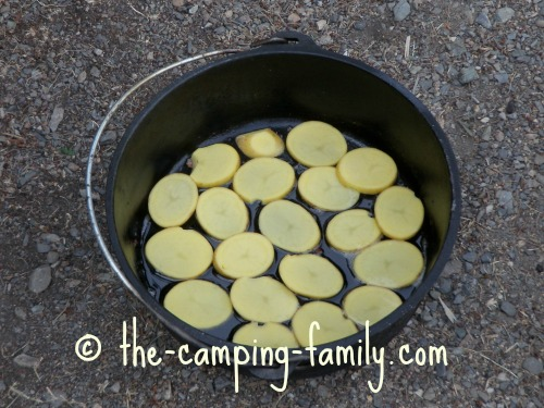 sliced potatoes in Dutch oven