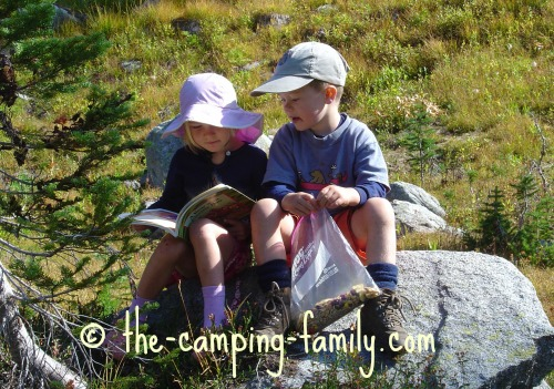 two children reading on the trail