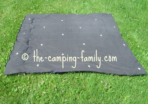 rectangular sleeping bag open on grass