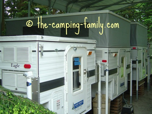 row of popo up truck campers