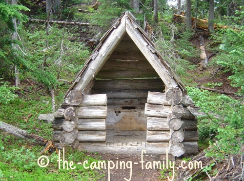 rustic outhouse in the woods