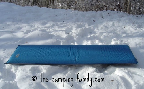 self inflating sleeping bag on the snow