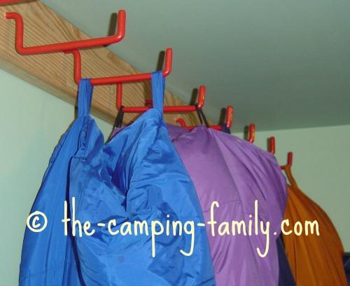 sleeping bags hanging on hooks