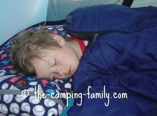 boy in synthetic sleeping bag