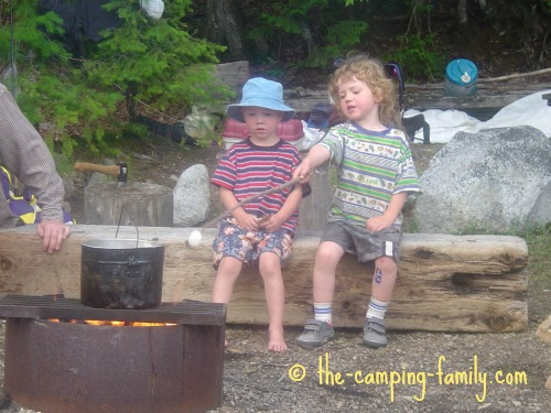 boys roasting marshmallow