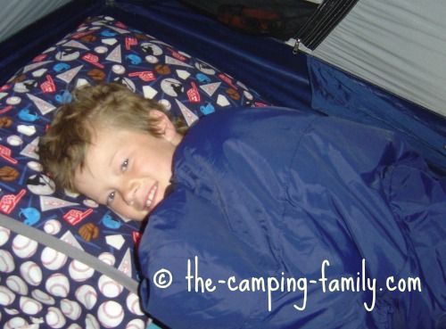 boy in childrens sleeping bag