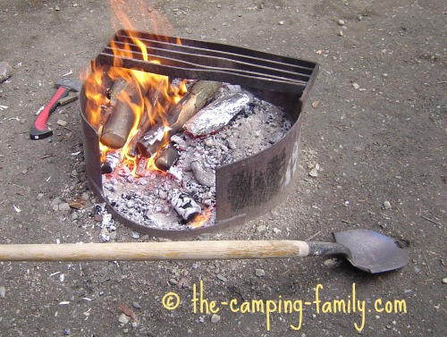 campfire and long handled spade