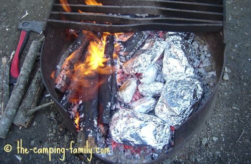 campfire with tinfoil dinners in coals